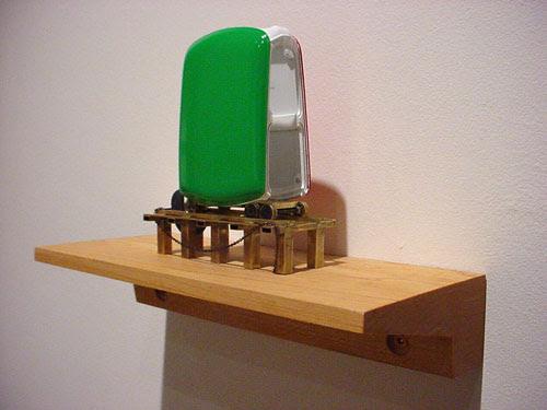 """Kim Adams, Maquette for Mini Ride, 2006, model parts and brass, 7"""" x 10"""" x 3.5"""" (incl. shelf)."""